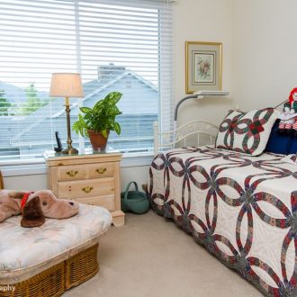 A small bed for guests in the Dogwood floor plan at Ardenwoods.