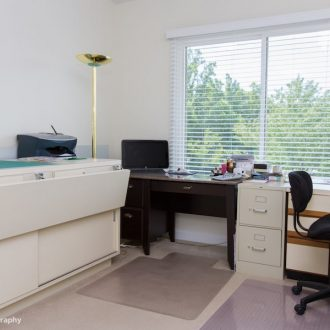 A bedroom being used as an office in the Dogwood floor plan.
