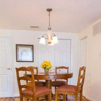 A kitchen table with chairs in the Dogwood floor plan.