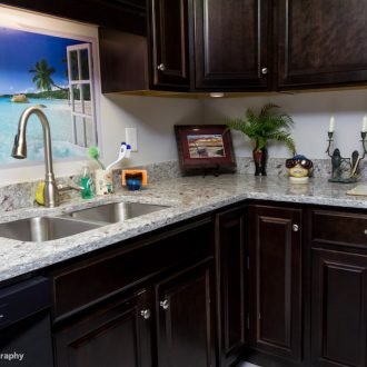 Beautiful granite countertops in the kitchen of the Laurel floor plan.
