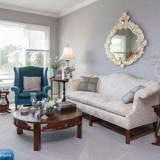 A beautiful sofa with embroidered fabric in the Laurel floor plan at Ardenwoods.