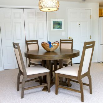 The dining room table in the Azalea floor plan.