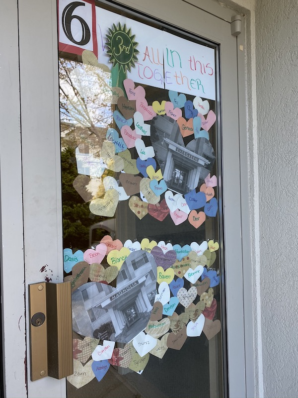 A window with paper hearts attached to the glass.