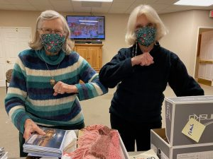 ardenwoods residents pack meals on wheels boxes