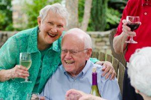 retired couple drinking wine