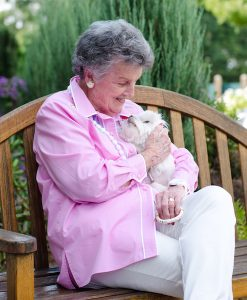retired woman holding dog
