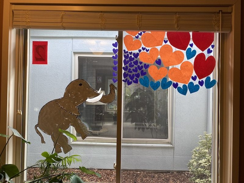 A window with a drawing of an elephant on it.